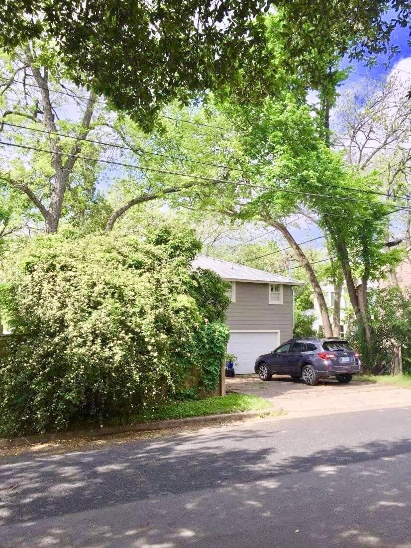 Large oak trees and mature pecan trees surrou