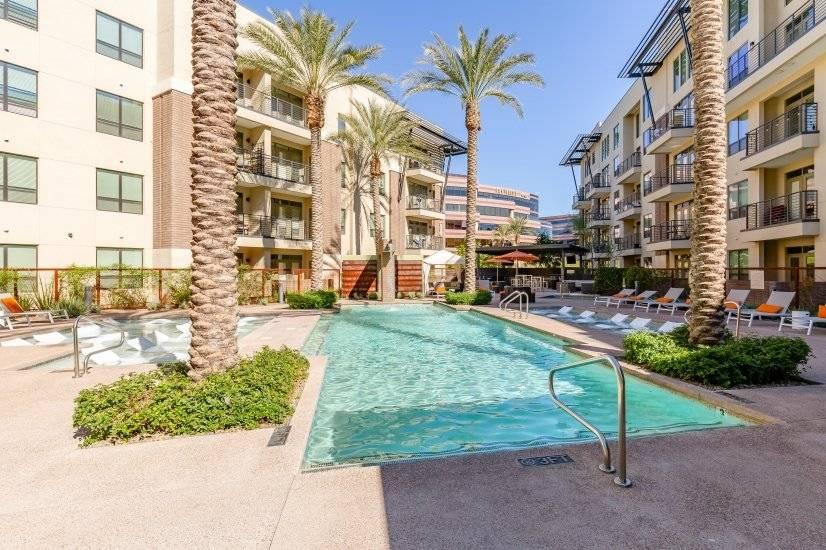 Heated Community Pool & Spa w/ in pool loungers & waterfal