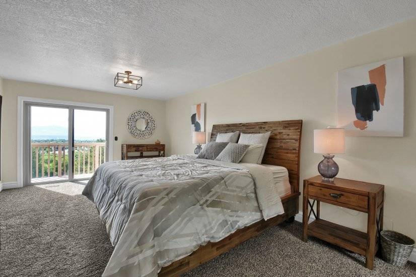 Master Bedroom with King Size Bed and Balcony Access