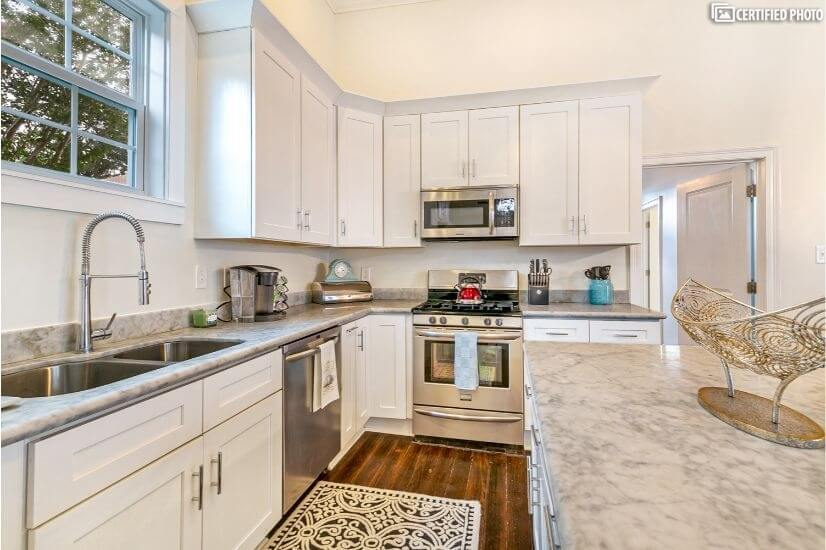Upgraded kitchen with marble counters and large island