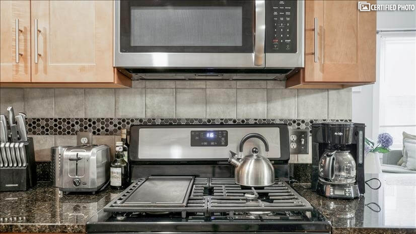 Granite top stainless steel modern kitchen