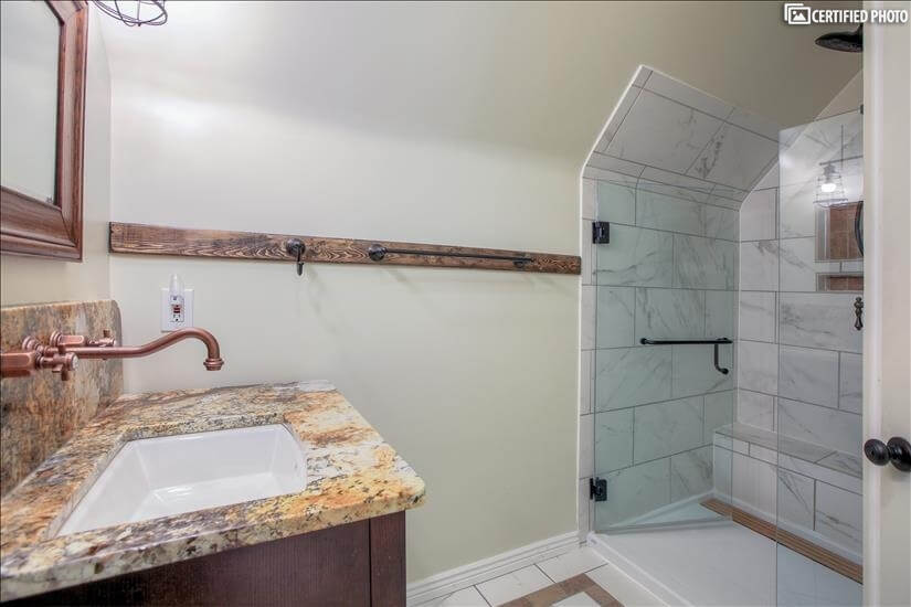 Upstairs - spa-like glass enclosed large shower with bench