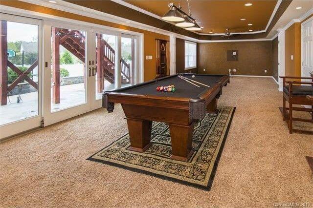 Basement living room french doors pool table