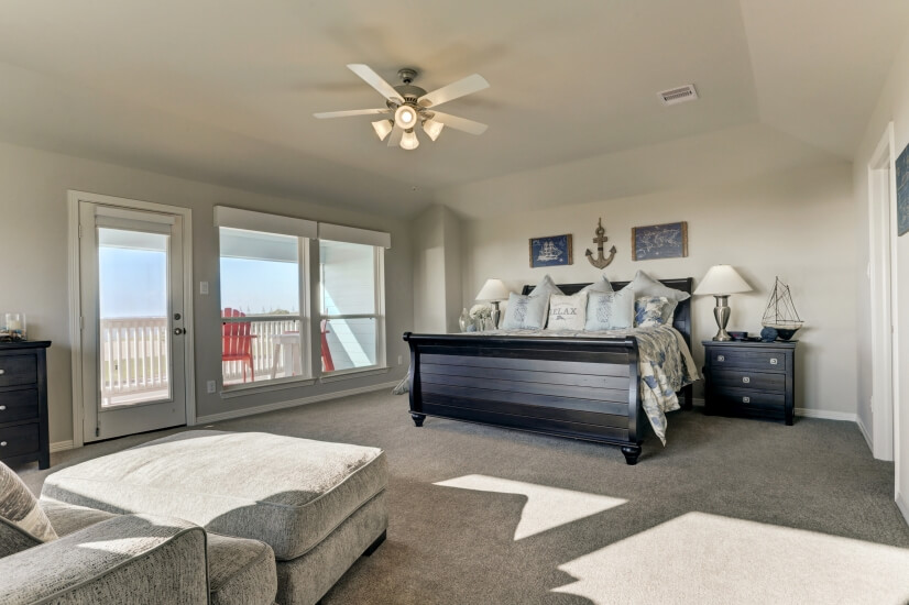Huge master suite with private balcony and king bed.
