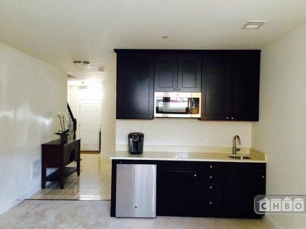 Brand new kitchenette with oversize cabinets