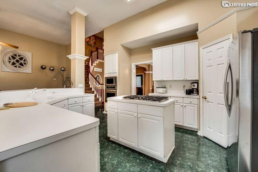 Bright white cabinets in spacious open kitche