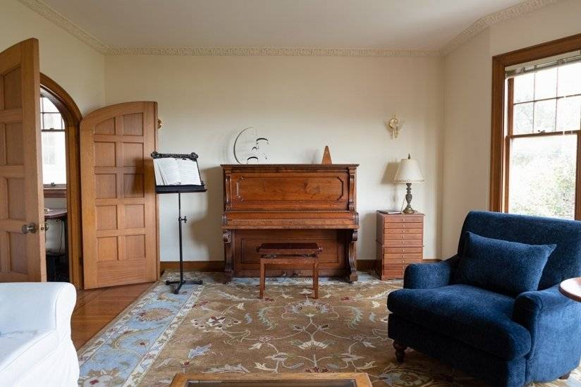 Large east facing living room with Steinway upright.