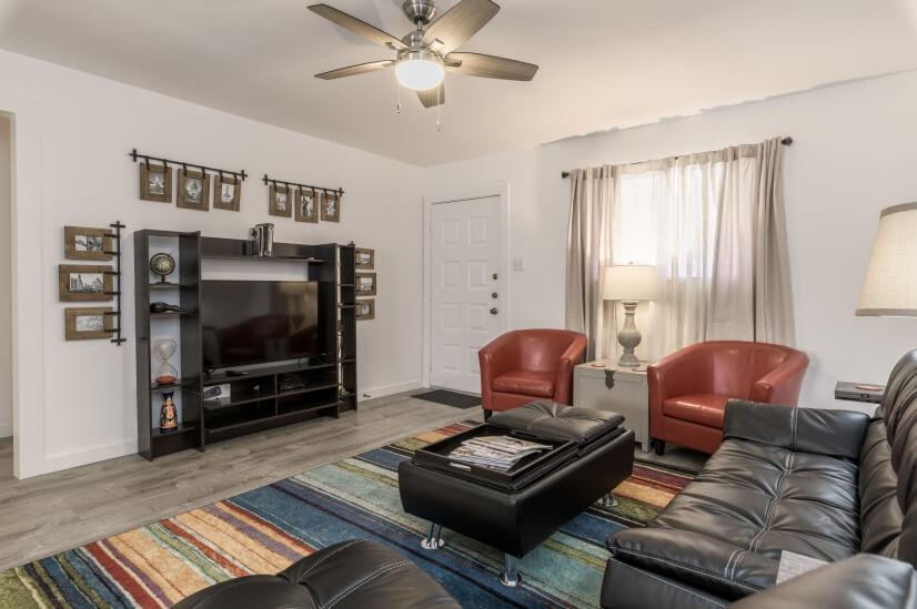 Living area, front door to condo