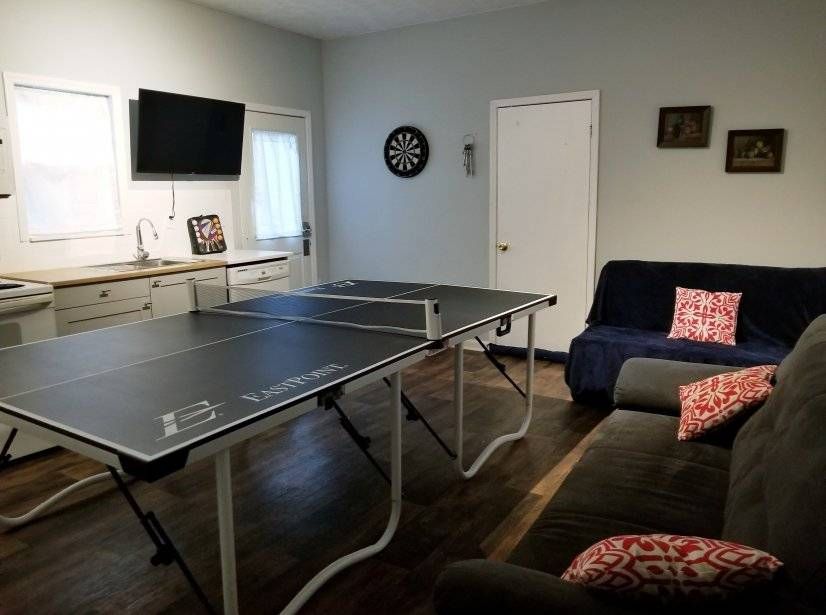 "Game room with full size ping pong, 42"" TV, darts, full kitc"
