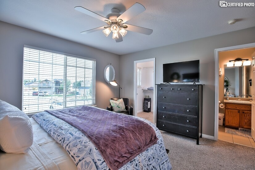 Master Bedroom with smart TV and walk in closet