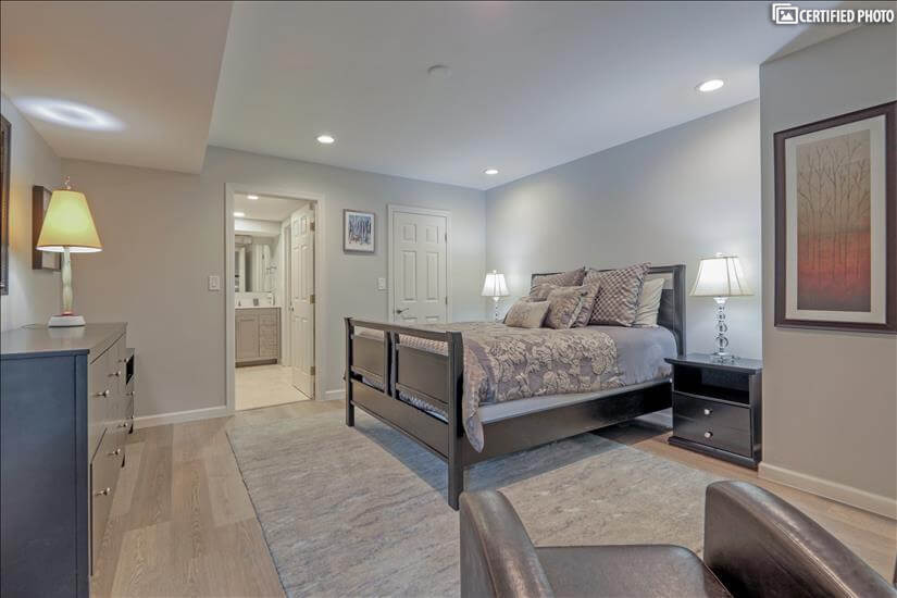 Master bedroom with queen bed viewed from siting area