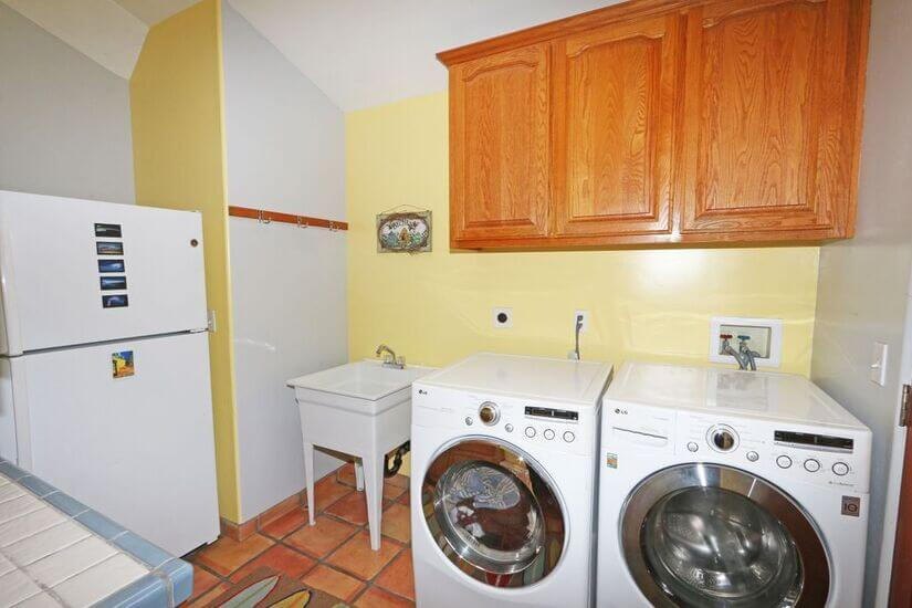 Laundry room with second refrigerator