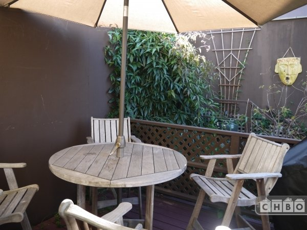 Great 4-person patio seating with umbrella