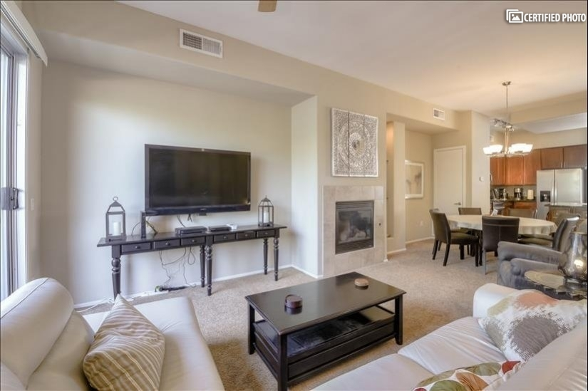 Living Room with Big Screen TV & Fireplace