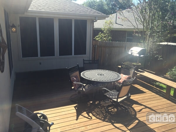 large deck with seating and grill