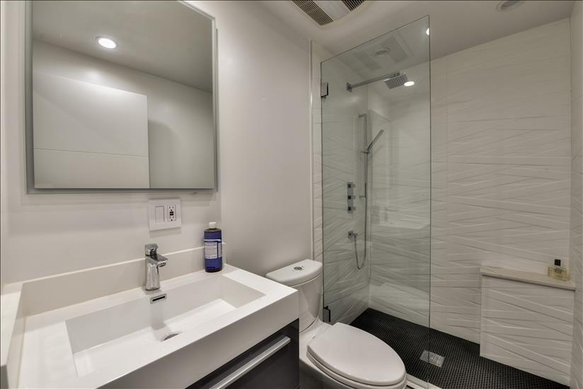 MAster bathroom with Toto toilet and bathtub