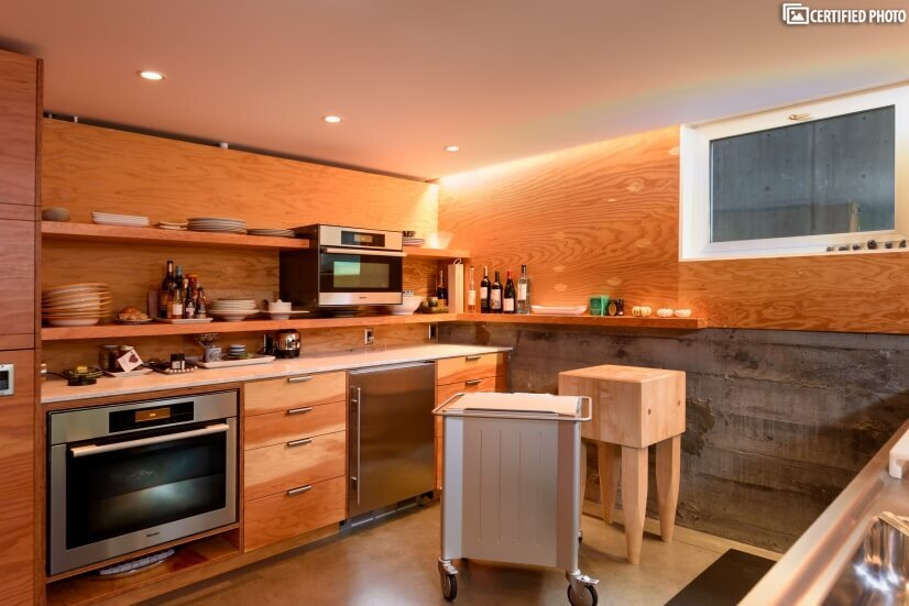 High-end kitchen features with Miele oven and microwave
