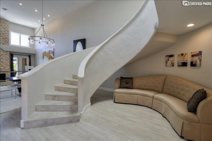 Enter through the front door to a grand spiral staircase.