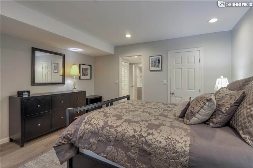 Master bedroom with large bureau and walk-in closet