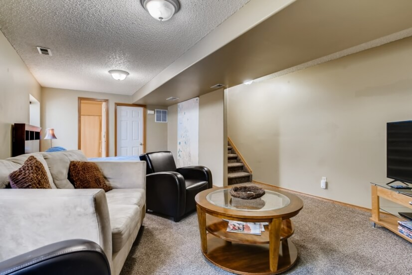 """Lower level living room with 50"""" smart tv"""