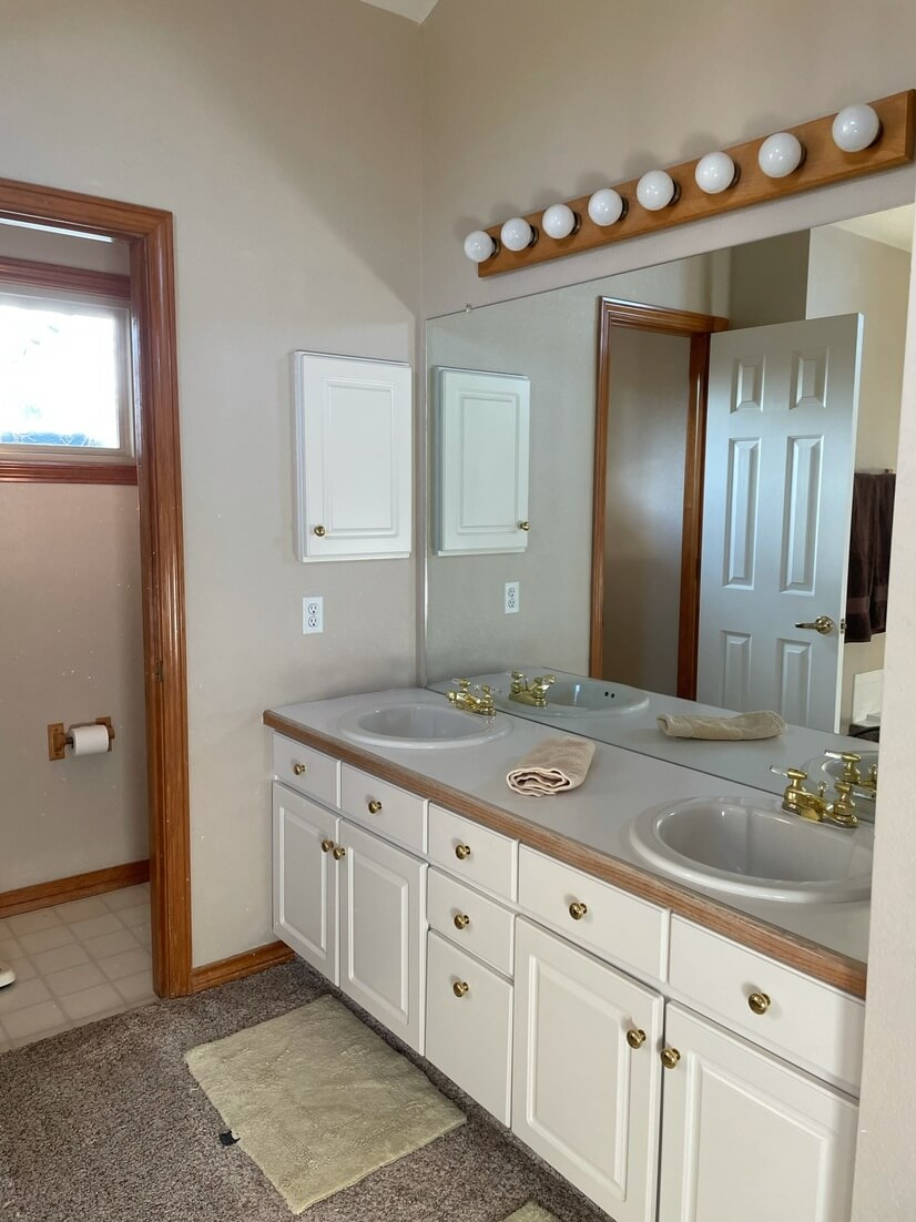 Master bathroom with water closet