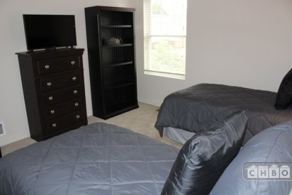 Twin beds with Dresser and Flat Screen Television