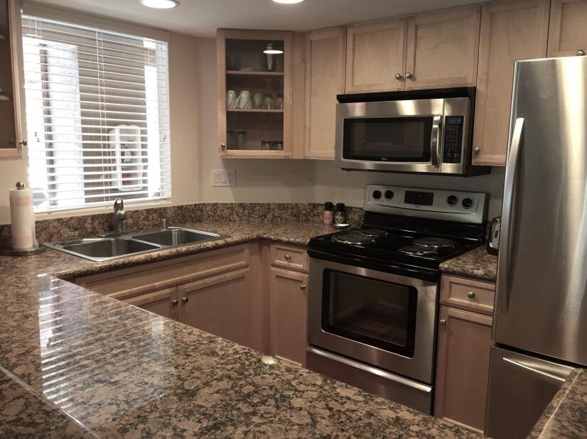 Kitchen with granite countertops & stainless
