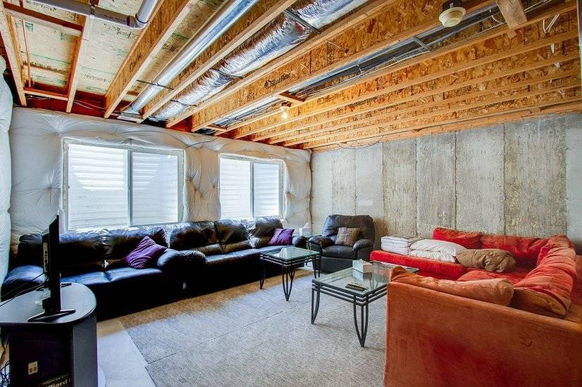 Basement recreation area with a sleeper sofa