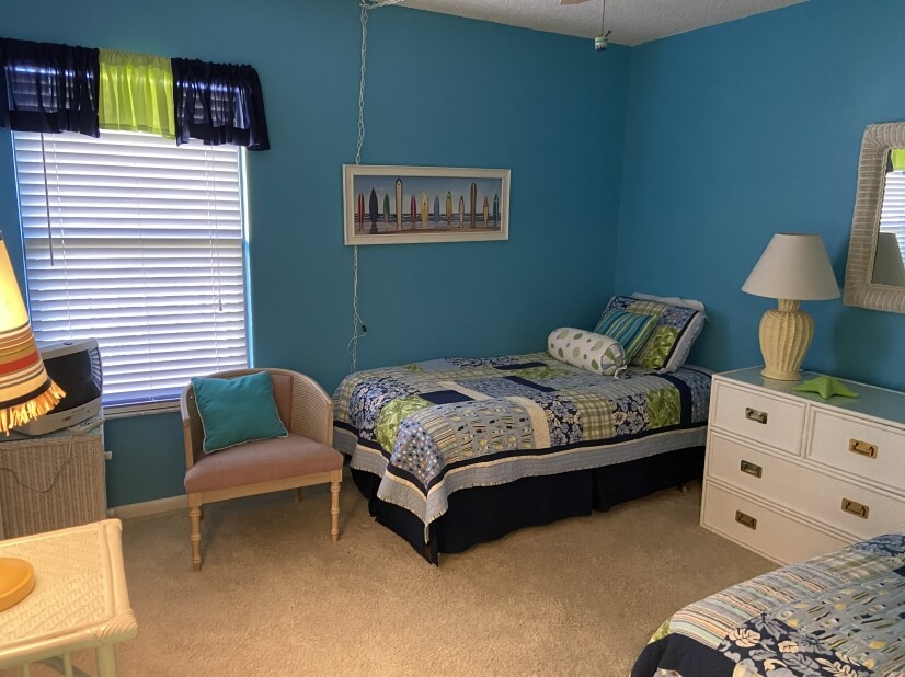 Spacious second bedroom with two twin beds.