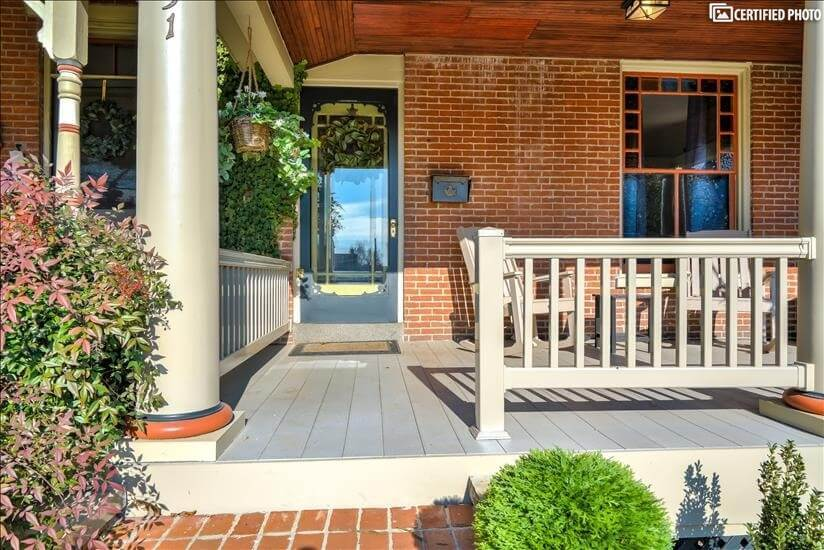 Porch with Railing and Front Entrance