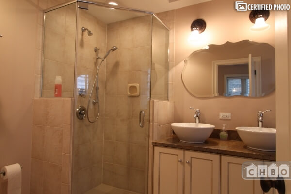 Master bath with a separate shower and whirlpool tub.
