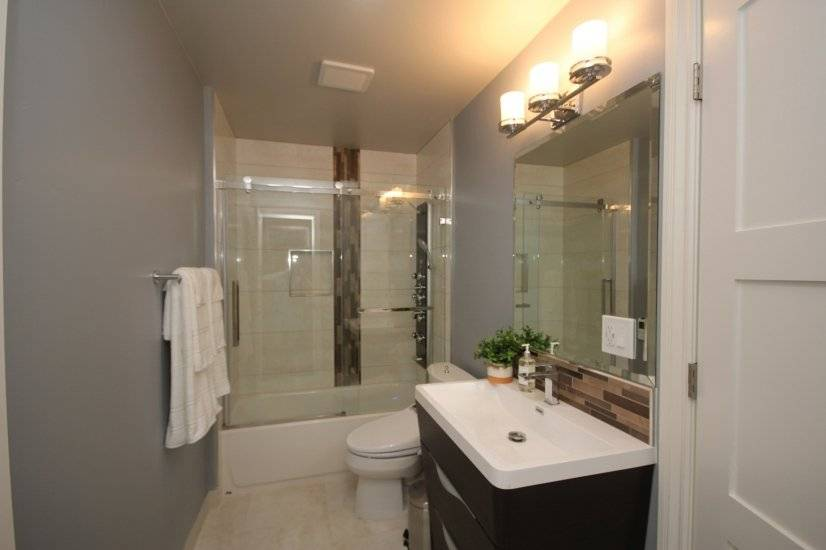 Gorgeous bathroom with shower panel over tub
