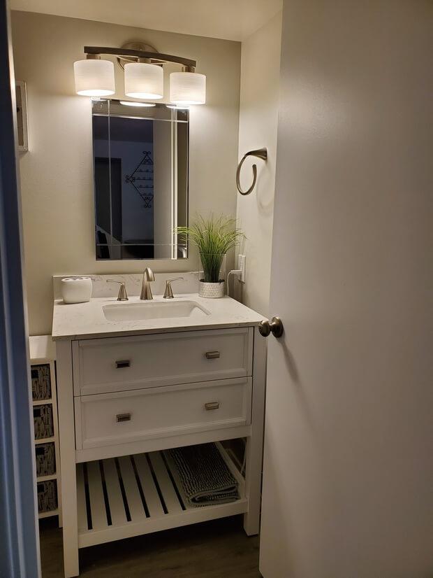 Bathroom with towel warmer behind the door