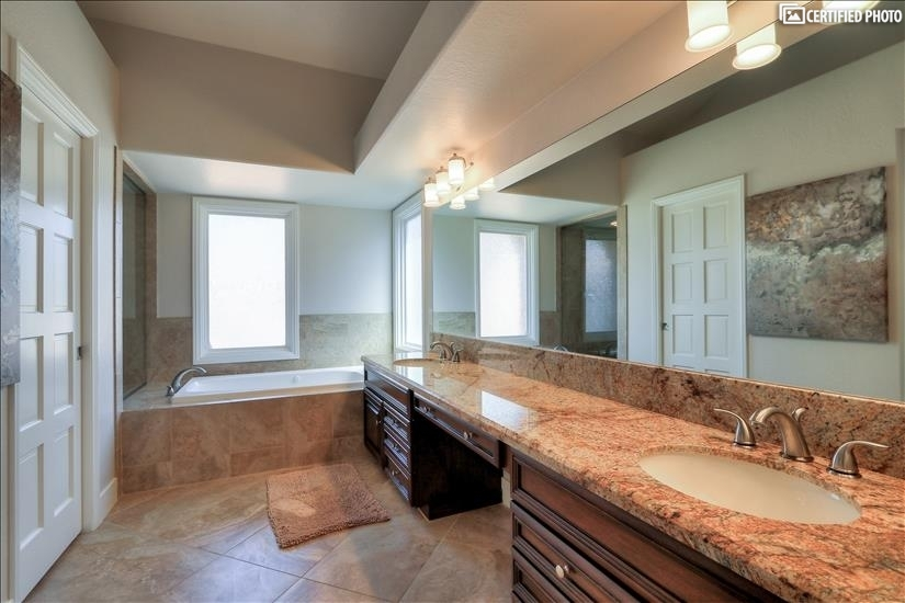 Upstairs Master suite bathroom with double sink & jacuzzi