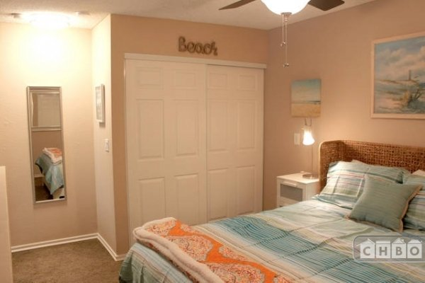Cozy bedroom with queen size bed and closet