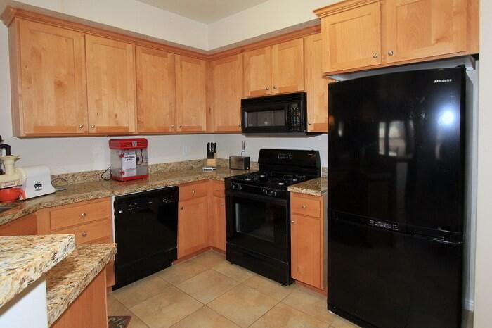 Kitchen with dishwasher, gas range, microwave
