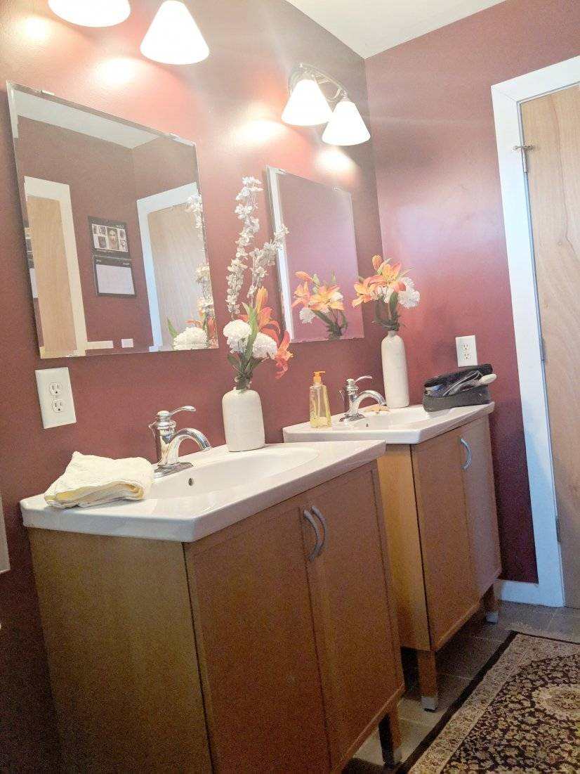 Upstairs Full Bathroom with twin vanity and dimming lights