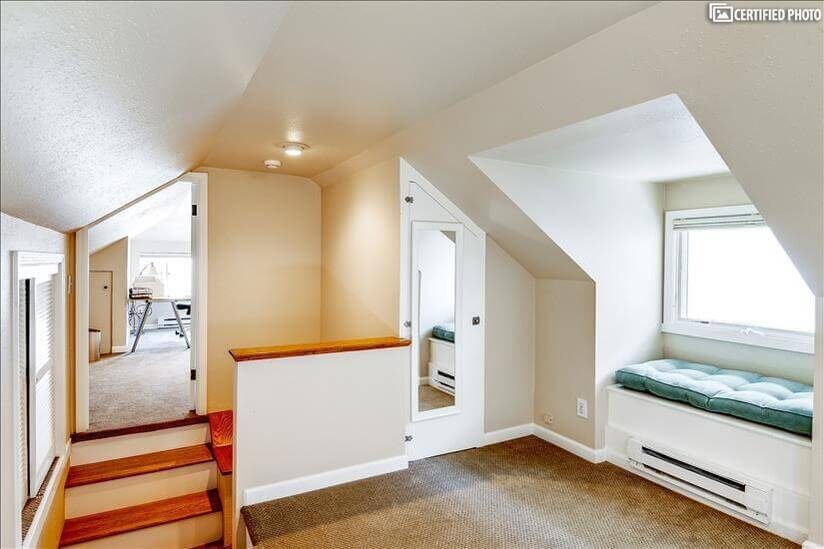 Upstairs sitting area with 2 closets and room
