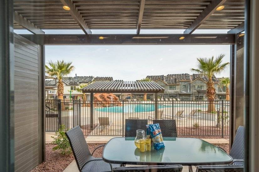 Poolside patio with dining table and barbecue