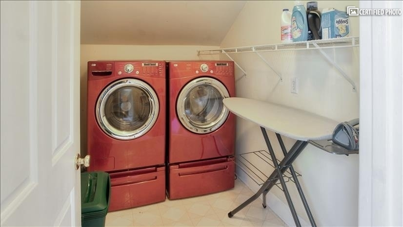 Laundry room directly across from office