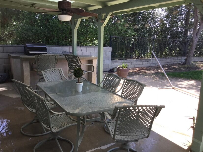 Gas BBQ and outdoor dining area complete the backyard.