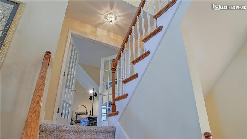 Stairway to second level family room