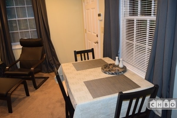 Dining Room Table / Comfy Leather Chair and Ottoman