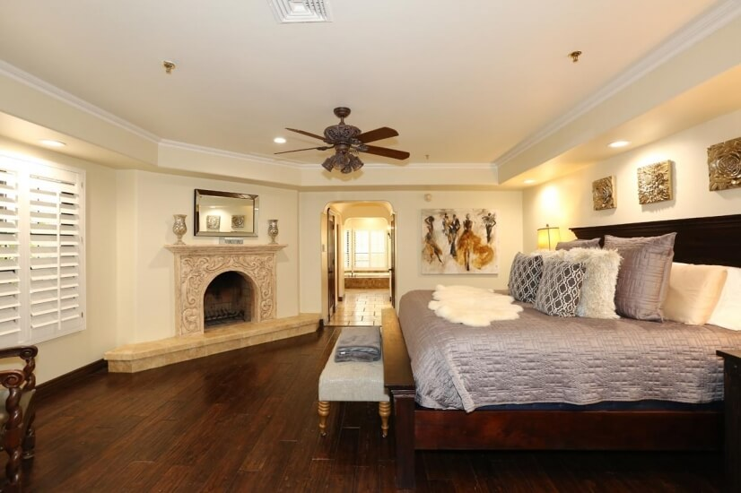 master bedroom with king bed and fireplace!