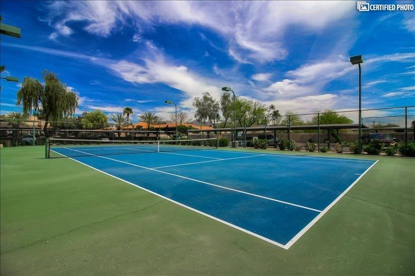 Year around fun in this enclosed tennis court