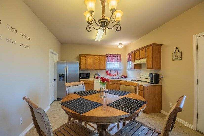 Open kitchen area. Laundry room includes washer and dryer.
