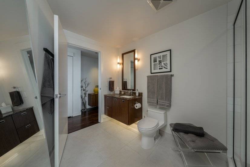 Enter guest bathroom from the hall or private