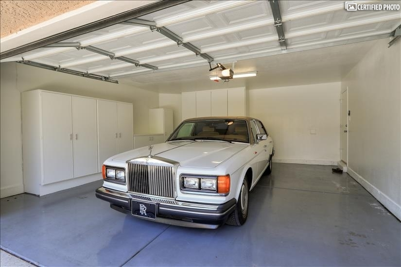 Two car garage with cabinets for plenty of storage!
