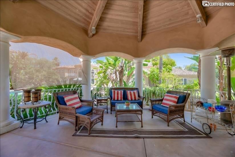 Nice veranda with comfy wicker furniture.