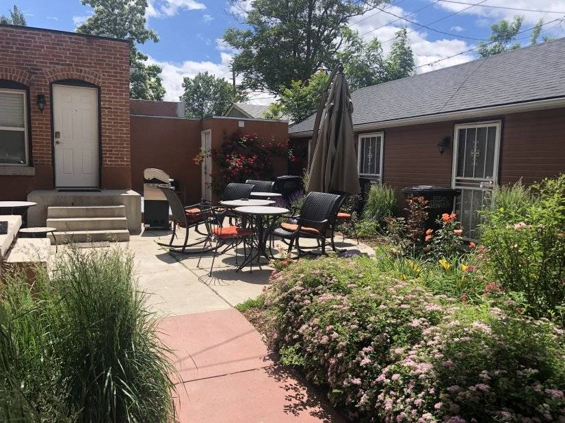 The back patio and gardens have a bbq and plenty of seating.